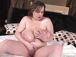 BBW Traci D. shows off her chunky boobs at hand an increment of plays at hand her pussy