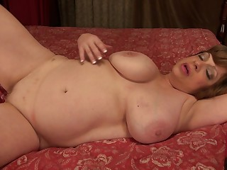 Mature amateur short haired BBW Piper C. strokes her shaved pussy