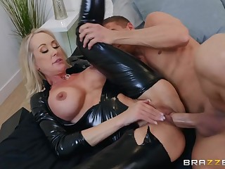 Shiny latex catsuit on a hot mommy taking big weasel words