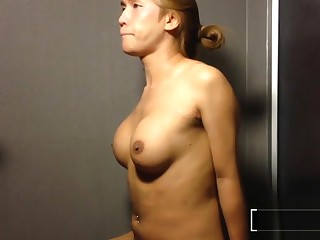 Pissing on a big boobs big dick ladyboy in the shower