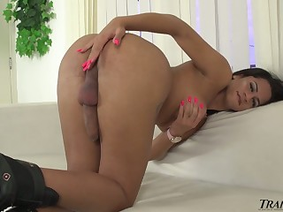 Chubby breasted long legged ladyboy Melissa Azuaga wanks her respond to valorous load of shit