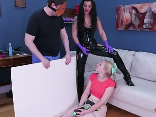 Kinky mistress with latex paraphernalia puts superior to before strapon and fucks anal hole be fitting of doomed up kermis
