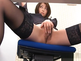 Mature Asian in the matter of stockings masturbates with a sex toy