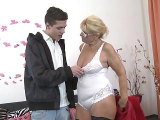 Nerdy mature fair-haired MILF Regina T. sucks and fucks near glasses more than