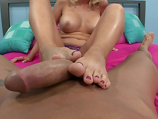 Blonde MILF Dylan Riley uses her exquisite feet about make a cock cum