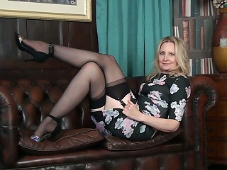 'tec together with quite leggy cougar Emma Turner undresses to pet her bald pussy