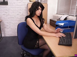 Baleful haired office clerk Tracy Rose flashes tits and wanks a fake cock
