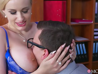Full-breasted MILF uses a younger guy's big cock for her pleasure