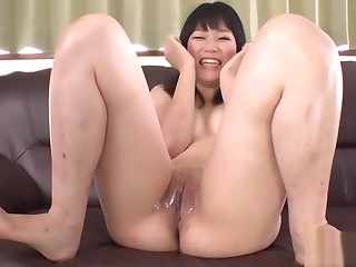 Oriental cowgirl with large butt plug