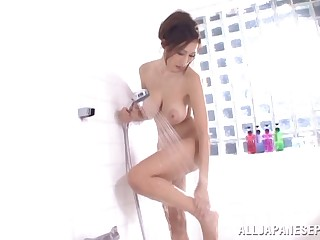 Sexy Asian trollop with huge tits playing with a stranger's cock