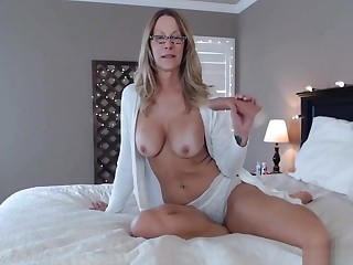 Older woman wearing that sexy teacher glasses and playing naughty there her bathrobe!