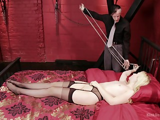 Petite blonde servant Samantha Rone tied up in all directions the bed and pleasured
