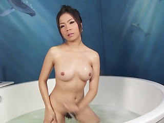 Lovely Asian girl Nanny strips and shows off her hairy pussy