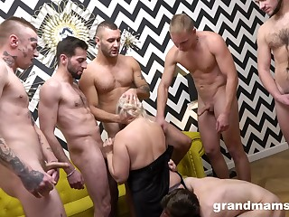 Older broad offers up her holes to a bevy of blokes during rough gangbang