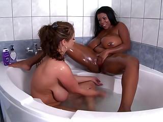 Chubby ass ebony goes intimate round busty white MILF