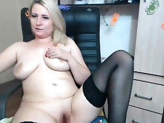 Blonde busty Brook Little plays with her big boobs